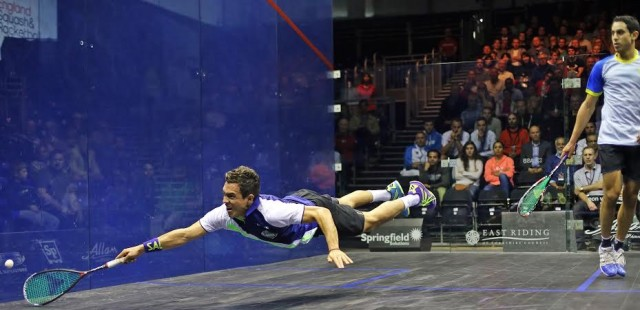 Miguel Rodriguez dives across the court