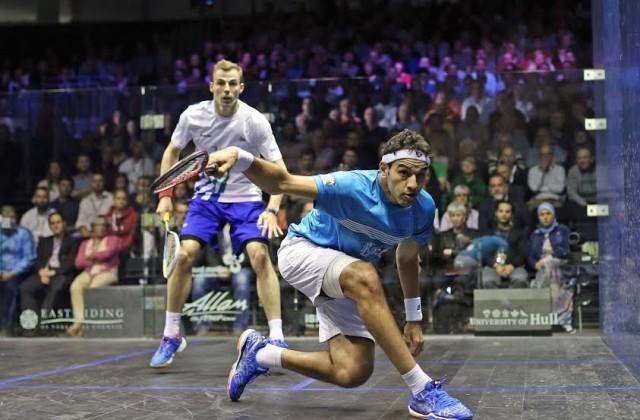 Mohamed Elshorbagy gets in front of Nick Matthew