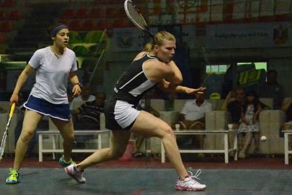 Heba El Torky watches as Line Hansen hits a backhand
