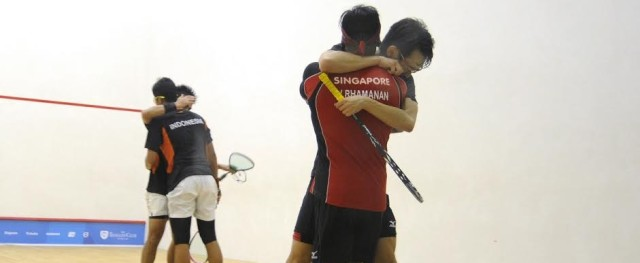 Both pairs lock in an embrace after the final at Tanglin Club