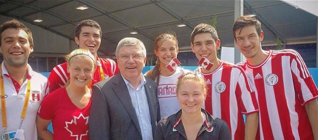 IOC boss Thomas Bach meets squash players during the Pan-Am Games in Canada