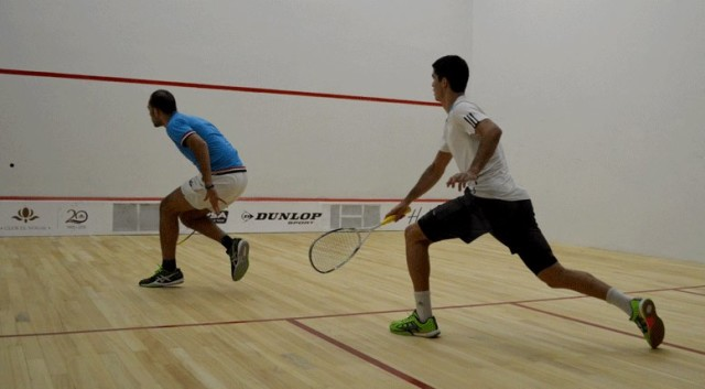 Diego Elias sets off in pursuit of a drop shot by Marwan Elshorbagy