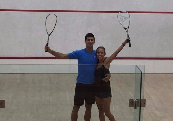 Novak Djokovic and his wife enjoy a game of squash on holiday