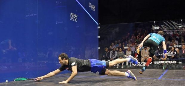 Ramy Ashour catches Gregory Gaultier as he dives across court