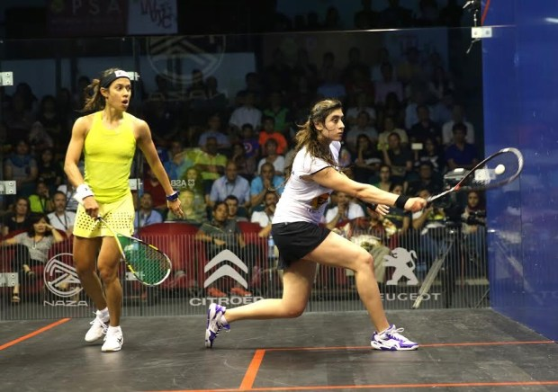 A look of panic crosses Nicol David's face as Nour El Sherbini lines up backhand volley