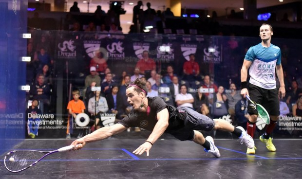 Paul Coll dives across court against Gregory Gaultier