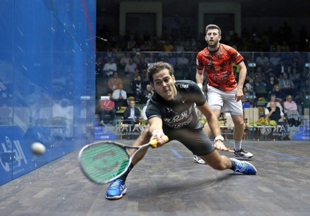 Karim Gawad moves forward for the ball against Daryl Selby