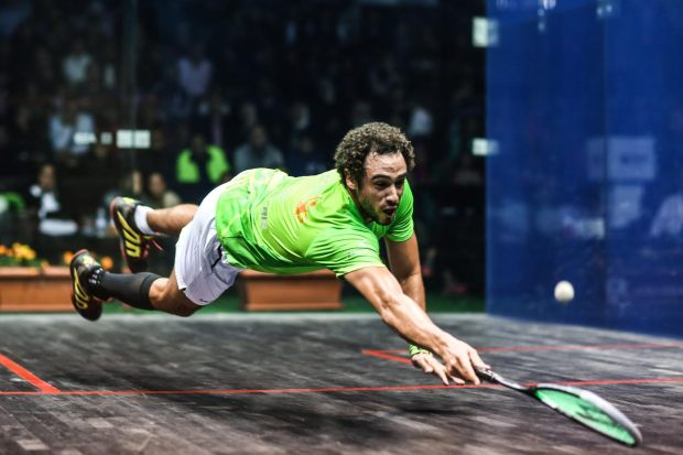 Ramy Ashour dives across the court