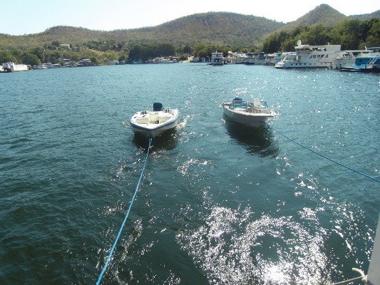 Towing the speedboats behind the houseboat.