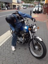 Colin checks his Bonnie for oil leaks. Yep! Still there!