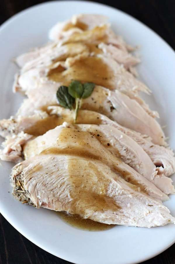 Slow Cooker Turkey Breast - SO EASY and doesn't take up room in the oven! Plus it's ultra juicy and tender! We're making this every year.