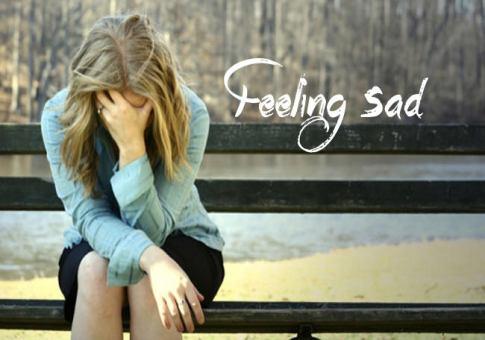 feeling sad girl alone on table