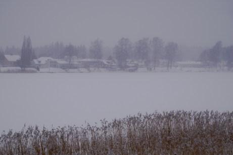 It's snowing and Klarälven is completely frozen