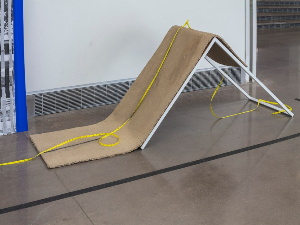 """Slump"", Sand and Iron on Rubber, Aluminum tubes, Measuring tape"