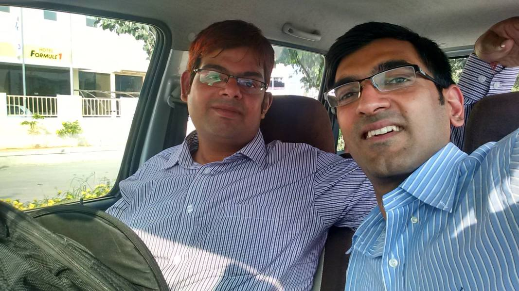 """sRide Team member, Nitin Chadha, travelling from GREEN COUNCIL meeting to HITEC City Hyderabad, India with GREEN CHAMPION of IT industry- """"Uday Shankar"""""""