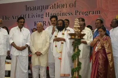 Dignitaries take to stage on the inauguration of the Art of Living Happiness program and mass recitation of Janappana. From (L-R) Mr Mr. S Krishna Kumar, former Union Minister, Noted Politician and Lawyer, Mr Ram Jethmalani, Film star and Politician, Devan, Founder of the Art of Living, Sri Sri Ravi Shankar, General Secretary of the Sree Narayana Dharma Paripalana (SNDP), Mr Vellapally Netesan and Ms. Preethi Natesan.