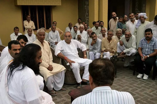 Sri Sri meeting community leaders at Kakda Village, Muzzafarnagar