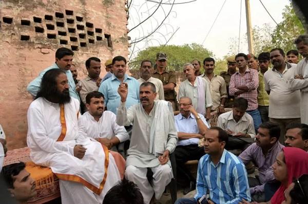 Sri Sri meeting the family of the Hindu victim in Malikpur Village, Muzzafarnagar
