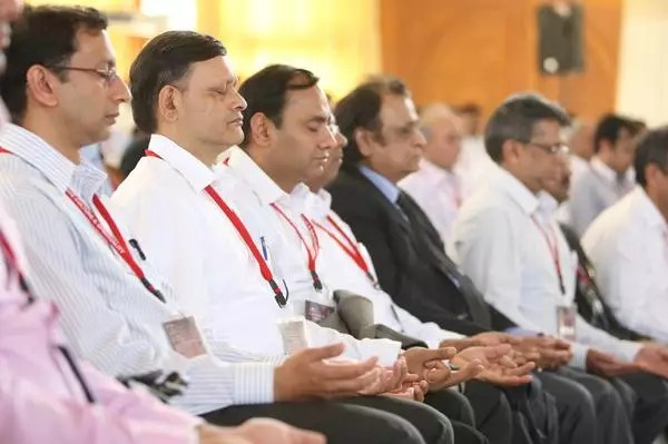 Corporate Culture & Spirituality Delegates and Speakers in meditation