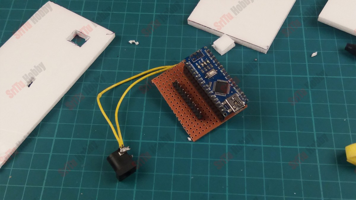 solder the female and male headers onto the dot board