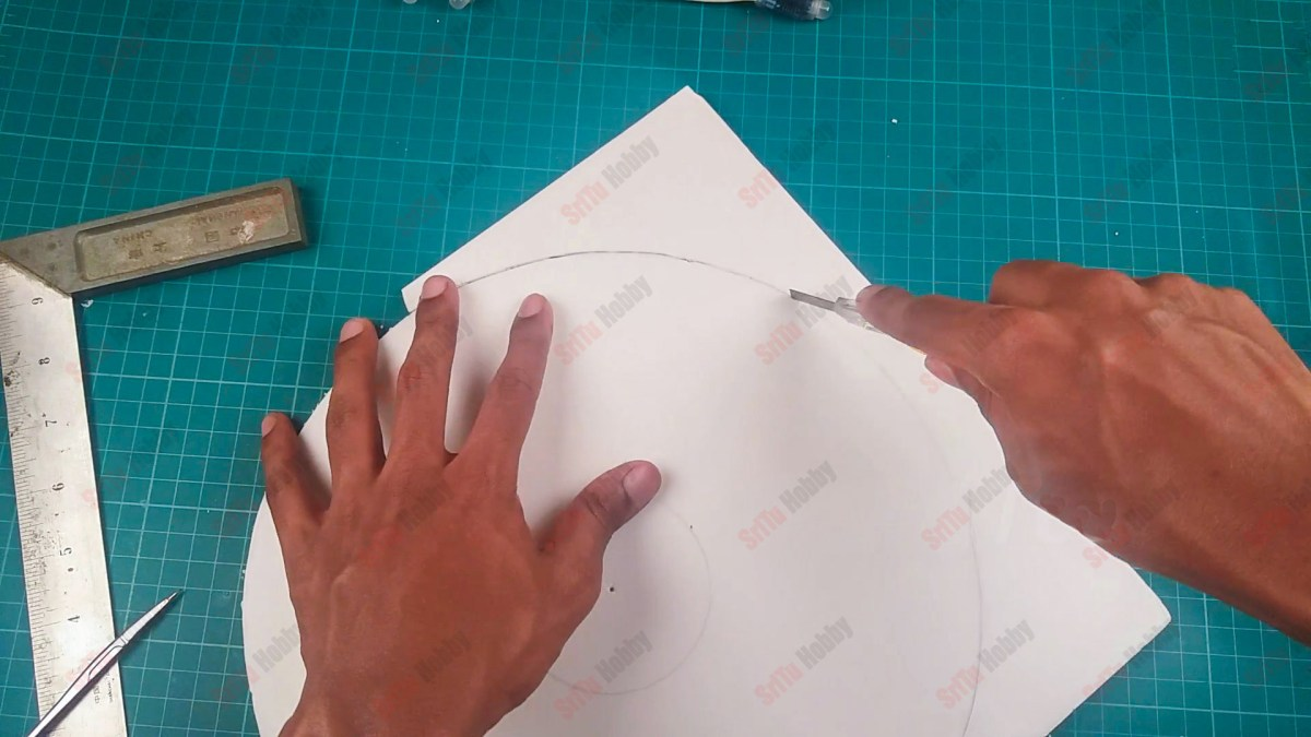 draw a circle with a radius of 5.5 on the foam board or cardboard. Afterward, cut it out.
