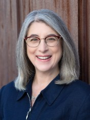 Headshot of Woman with Grey Hair and Glasses