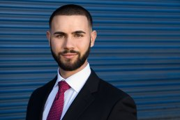 Outdoor Headshot of Young Man with Beard in Suit And Tie
