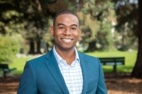 Realtor Headshot of Man in Park in a Suit