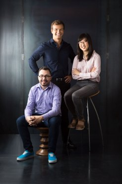 Portrait of 3 People in Front of Metal Background