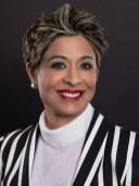 Woman in Striped Jacket in Headshot