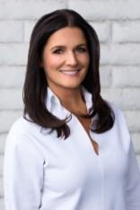 Premium Portrait of woman in white at white brick wall
