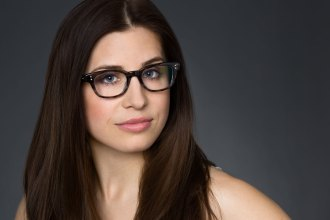 Smizing Brunette Woman with Blue Eyes and Glasses