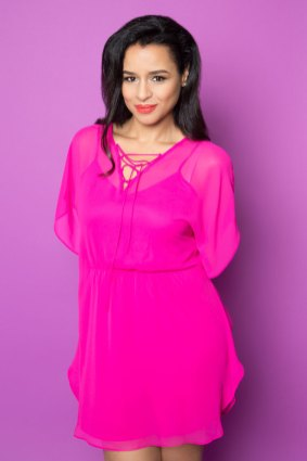Portrait of woman in Pink Dress on Purple Background