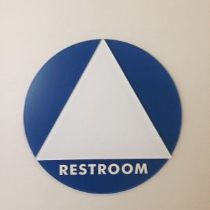 A gender-neutral bathroom sign