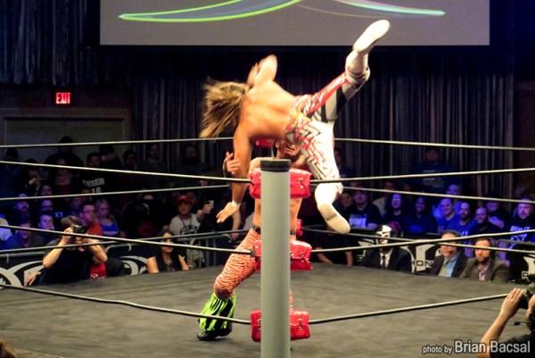 Hiroshi Tanahashi hits a High Fly Cross Body