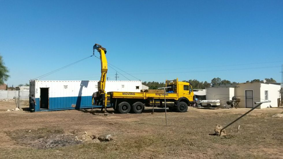 offloading the first shipping container