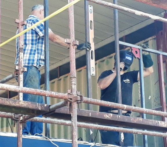 welding framing onto the shipping container house project