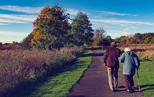 Couple walking outside at the skilled nursing home, assisted living, and short-term rehab center at SSC.