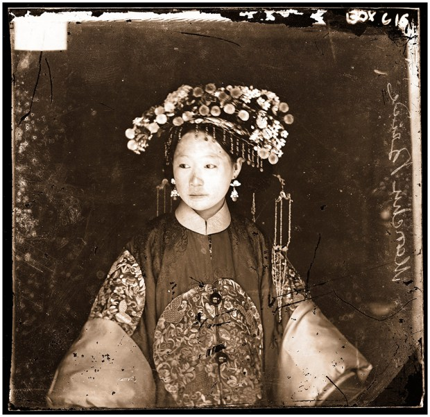 'China: a Manchu bride. Photograph by John Thomson, 1871