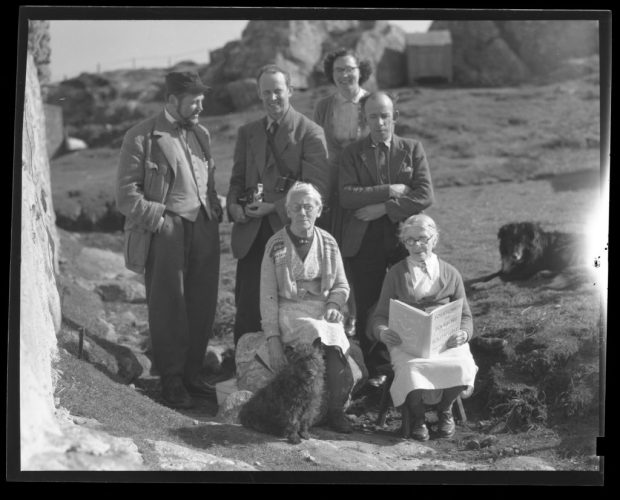 Film negative of Mairi Anndra (Mairi MacRae) and Peigi Anndra (Peigi MacRae) being presented with Margaret's book Folksongs and Folklore of South Uist.