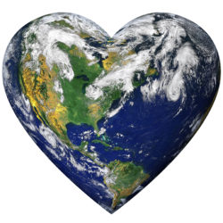 The planet earth shaped as a heart and isolated from the background with a clipping path.
