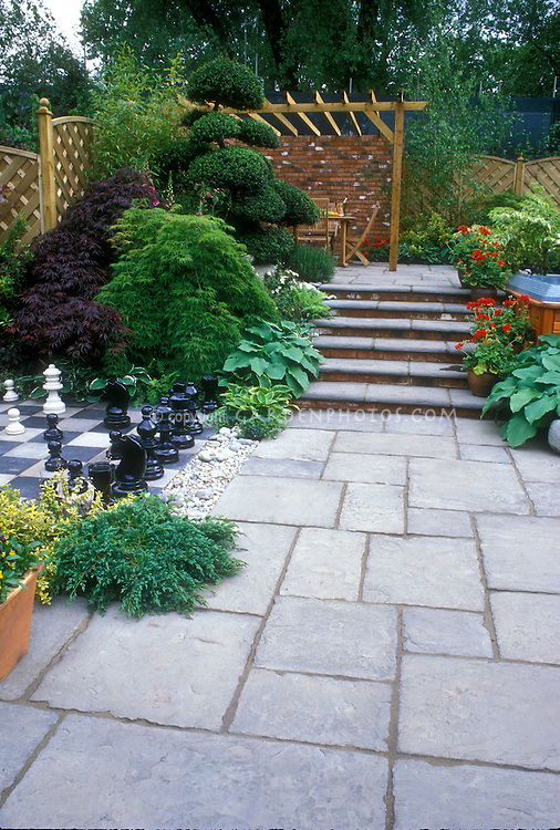 Bluestone Paver Patio With Inlaid Chess Set Plantings