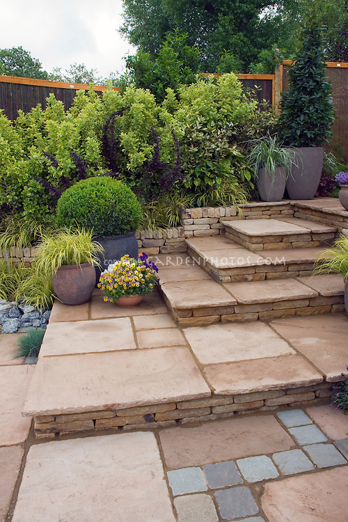 Tiered Patio With Mixed Paving Materials Design By Geoff