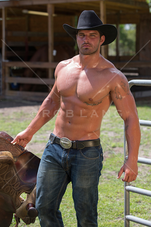 Shirtless Sexy Cowboy With A Saddle ROB LANG IMAGES