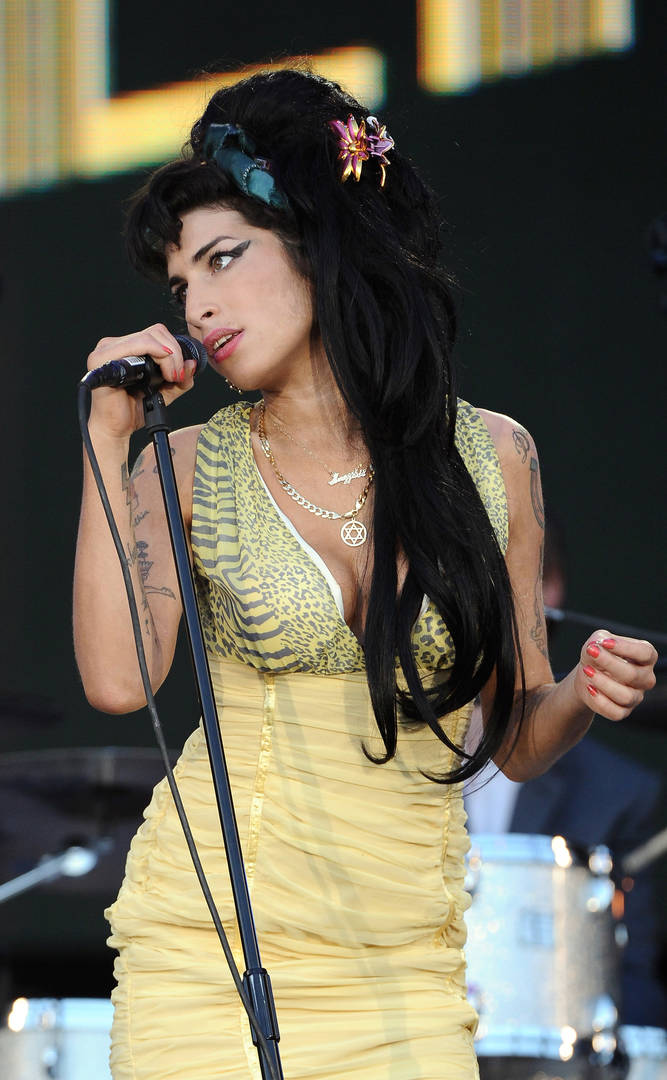 Amy Winehouse performs on stage during Rock in Rio Day 3 on July 04, 2008 near Madrid in Arganda del Rey, Spain.