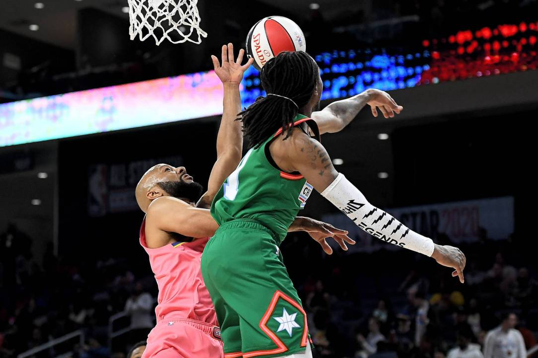 Team Stephen A. blocks a shot attempt by Common #25 of Team Wilbon during the 2020 NBA All-Star Celebrity Game Presented By Ruffles at Wintrust Arena on February 14, 2020 in Chicago, Illinois.