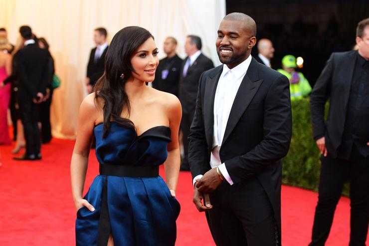 Kim Kardashian (L) and Kanye West attend the 'Charles James: Beyond Fashion' Costume Institute Gala at the Metropolitan Museum of Art on May 5, 2014 in New York City