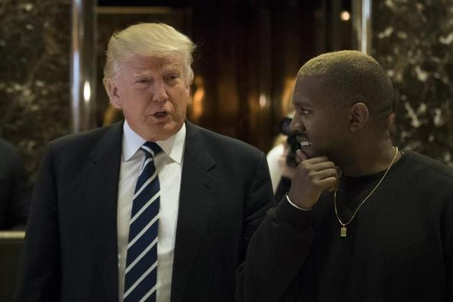 President-elect Donald Trump and Kanye West walk into the lobby at Trump Tower, December 13, 2016 in New York City. President-elect Donald Trump and his transition team are in the process of filling cabinet and other high level positions for the new administration. (