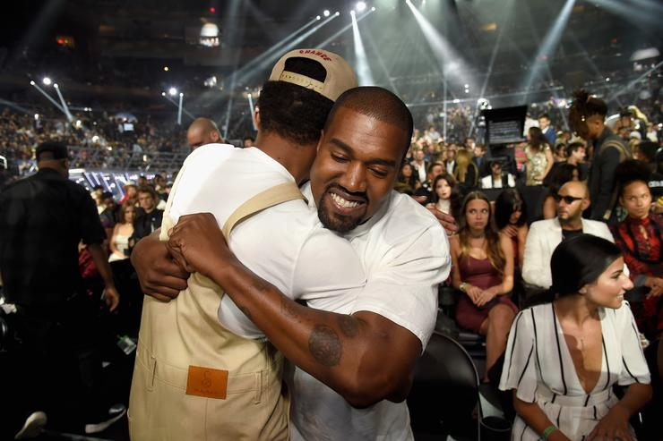 Chance the Rapper hugs Kanye West during the 2016 MTV Video Music Awards at Madison Square Garden on August 28, 2016 in New York City