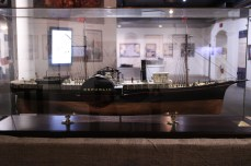Model of the paddlewheeler Republic. The screen behind has an interactive program to explore the wreck through videos & high-res photos.